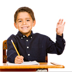 Elementary student raising his hand to be called on